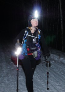 Bernadette walking in snow in dark w headlamp